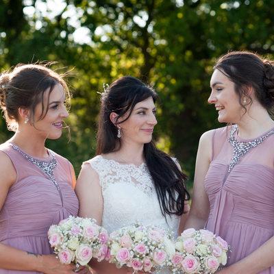 Bride and her bridesmaids at a beautiful summer wedding