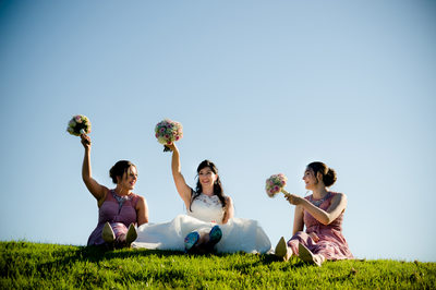 Bride and bridesmaids on a hot summer wedding day