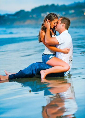 Pismo Beach Engagement Pictures couple in the water