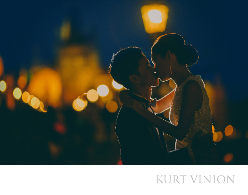 a kiss on the Charles Bridge at night pre wedding photo