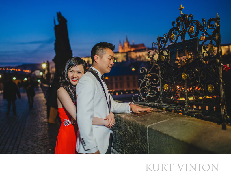 making a wish on the Charles Bridge - pre wedding photo