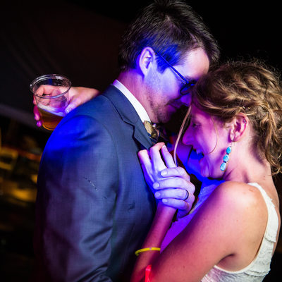 Intimate wedding dance moment between bride and groom