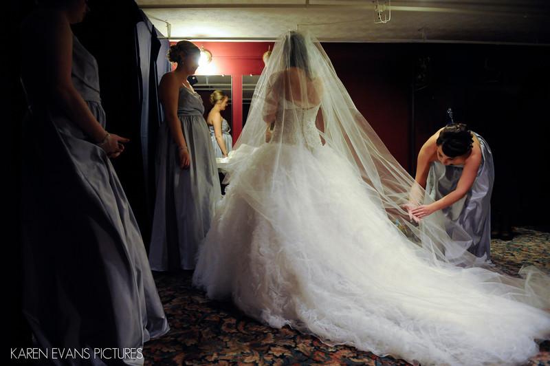 Bridesmaids Helping Bride with Veil