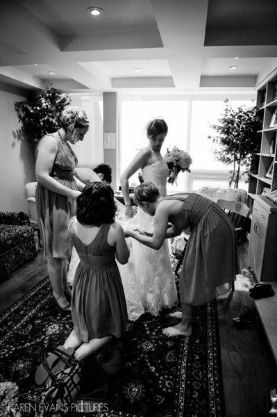 Bridesmaids helping bride at St. Mark's Episcopal