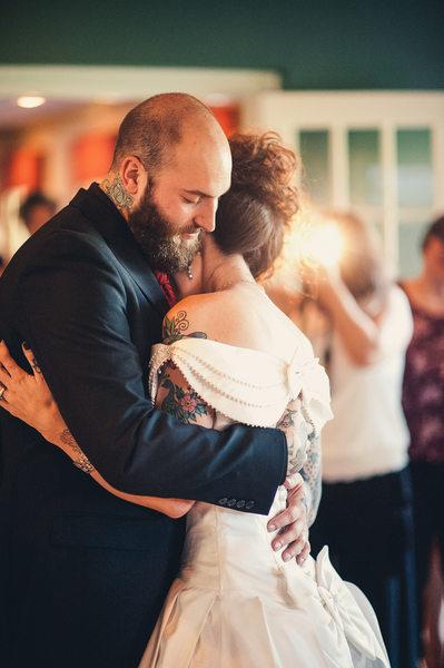 Tattooed Bride and Groom Dancing at Wedding