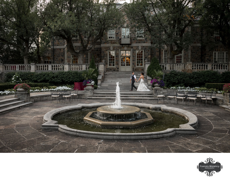 Couple Walking in Front of Fountain at Graydon Hall