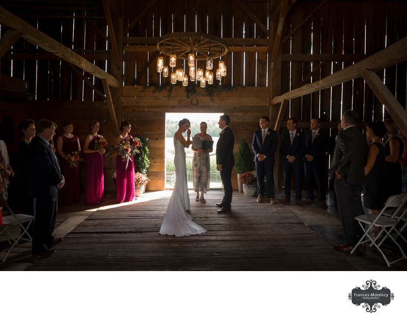 Barn Wedding Ceremony with Girls in Fuchsia Dresses