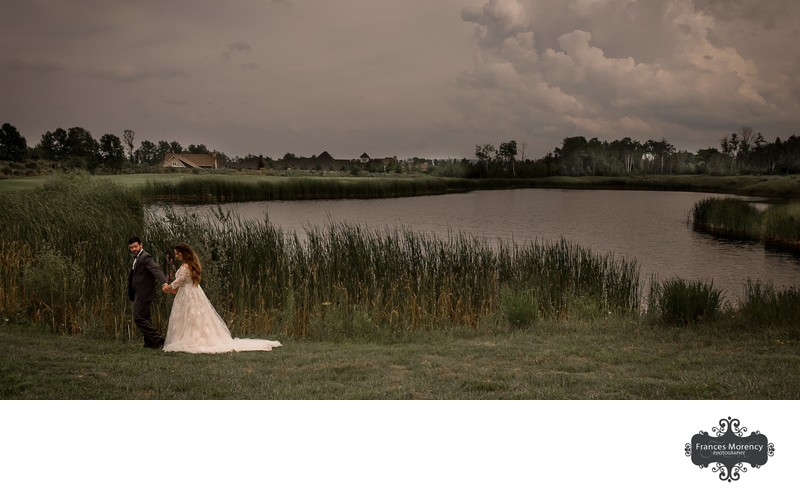 Bride and Groom Walking by Pond at Lora Bay Wedding