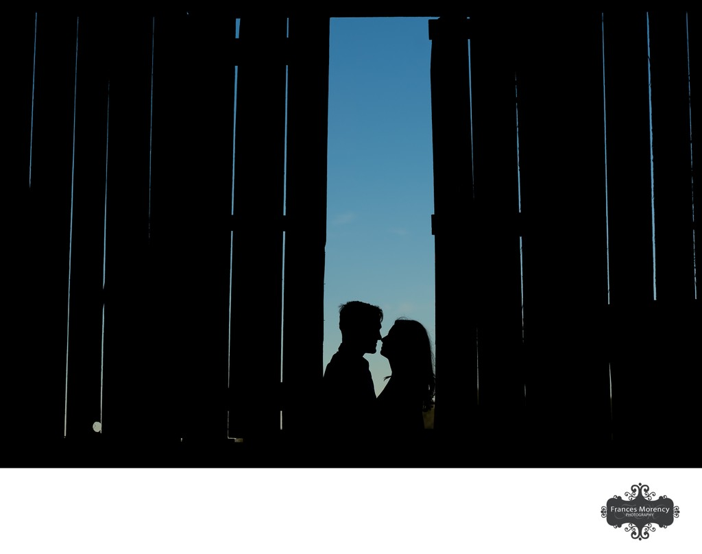 Silhouette Photograph with Engagement Couple in Barn