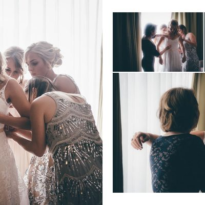 Bride Putting on her Dress with her Sisters and her Mom