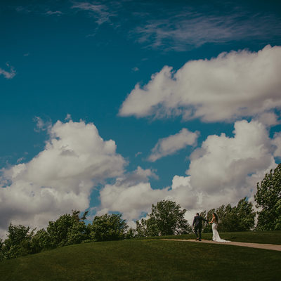 Bride groom walking up a hill at the Caledon Country Club
