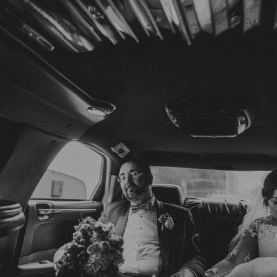 Toronto Ritz Carlton Wedding Photo of Couple in Limo