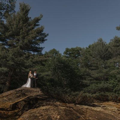Mukoka Elopement Photo of Bride Groom on Rocks