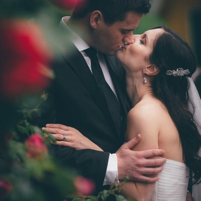 Wedding Couple Portrait in the Red Roses