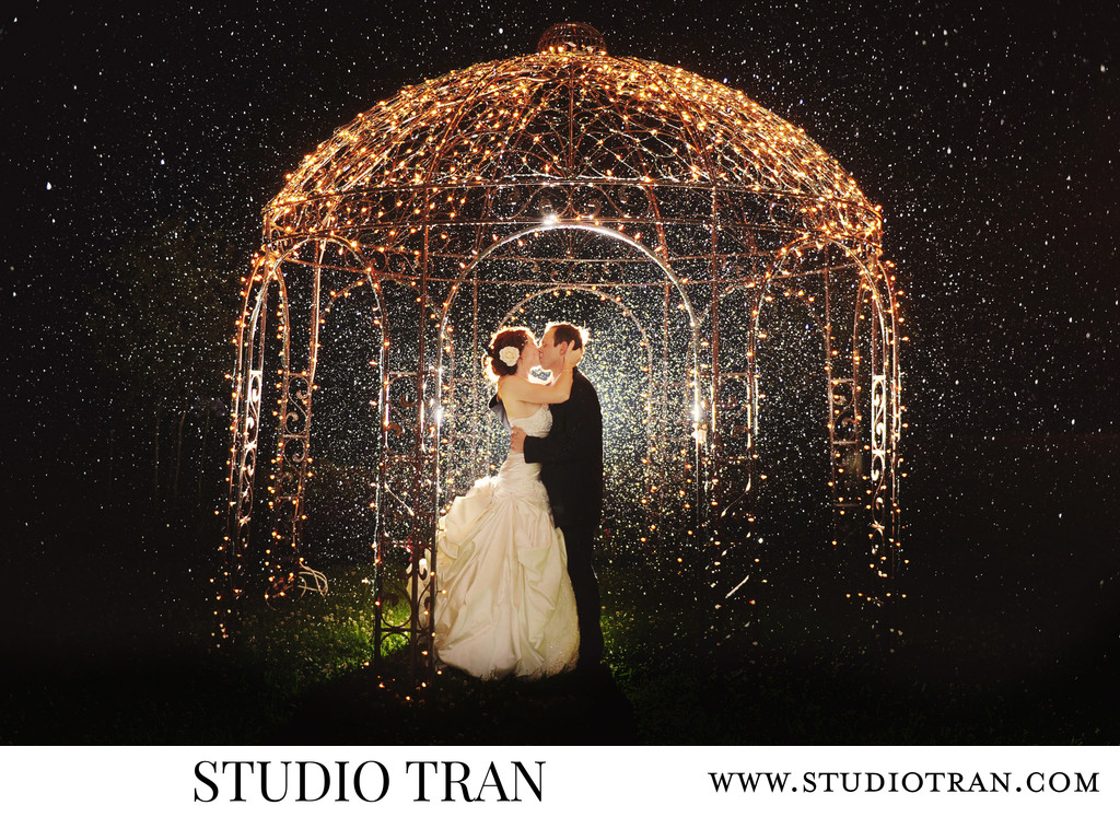 Kissing in the Rain Wedding Couple