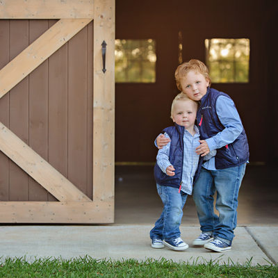 Elite Charlotte NC Sibling Portraits by a barn