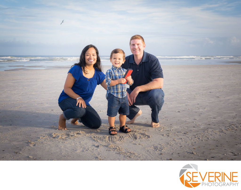 family pictures with a toddler at jacksonville beach