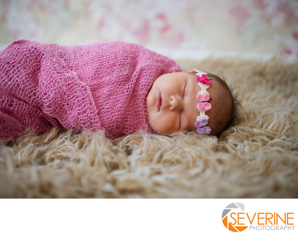 newborn girl with butterfly headset pose jacksonville photos
