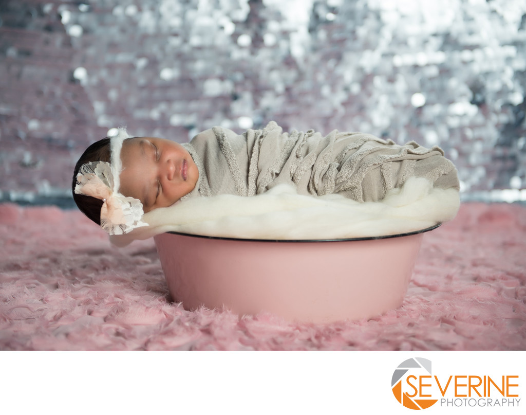 newborn girl in pink basket for photos jacksonville