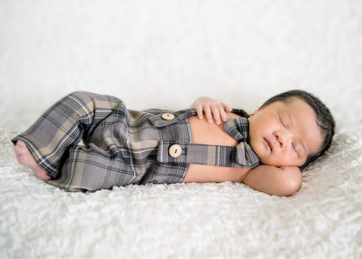 newborn boy with brown suit pose photos pictures