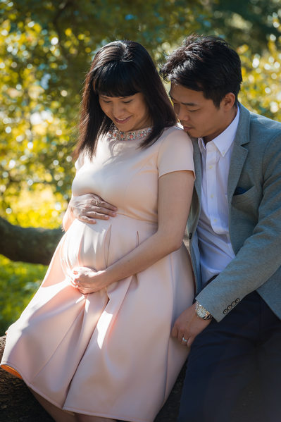 maternity photos pink dress oak tree park in jacksonville