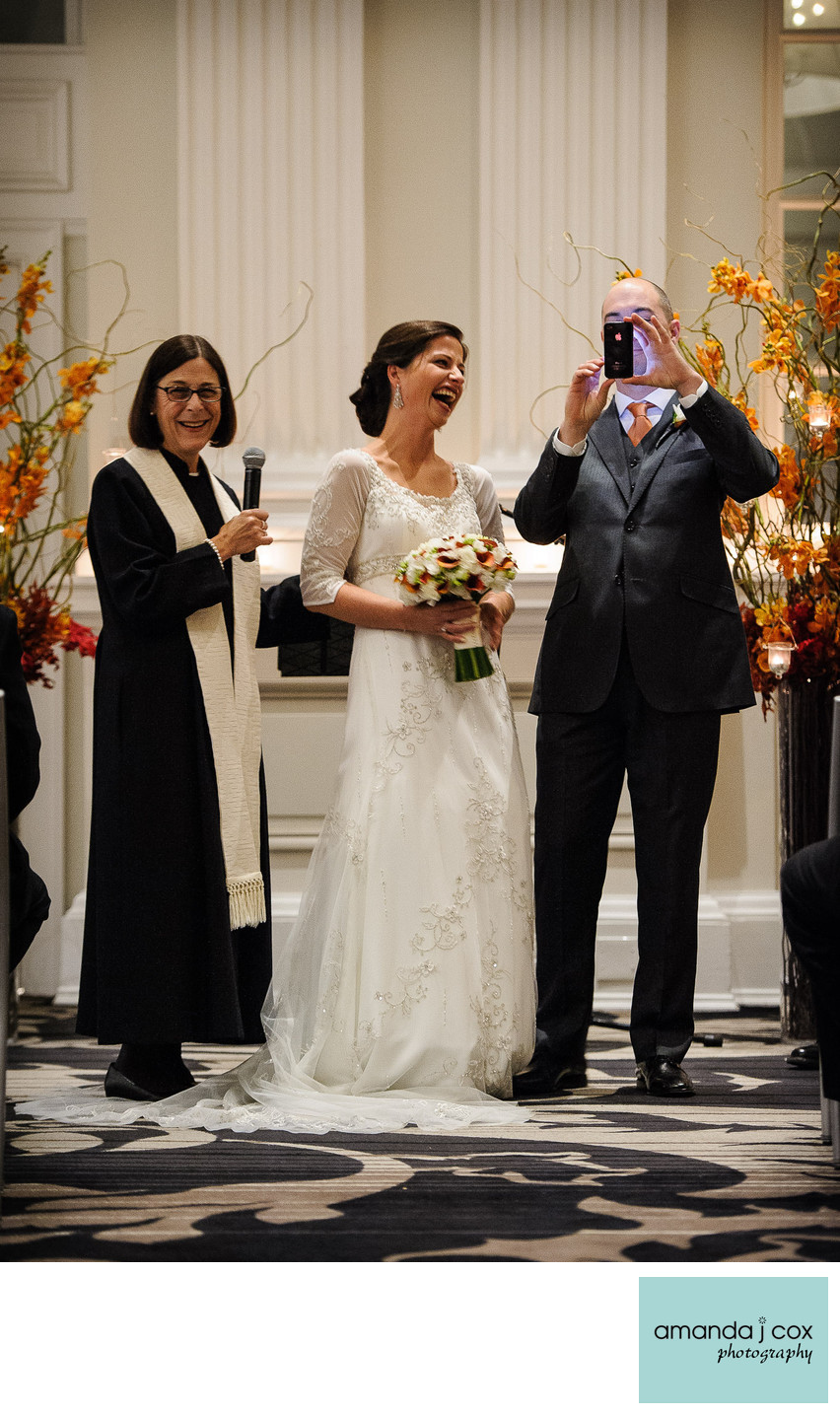 Groom pulls out iPhone at wedding