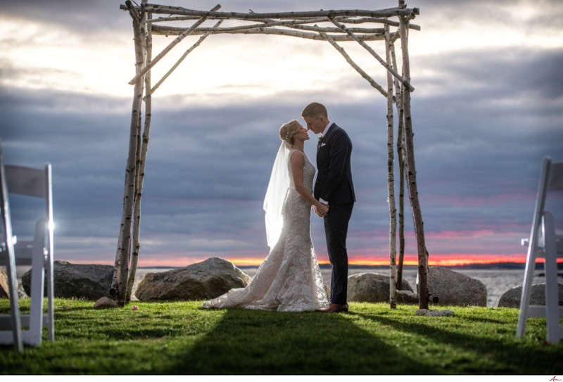 Oceanstone Couple embrace by the water