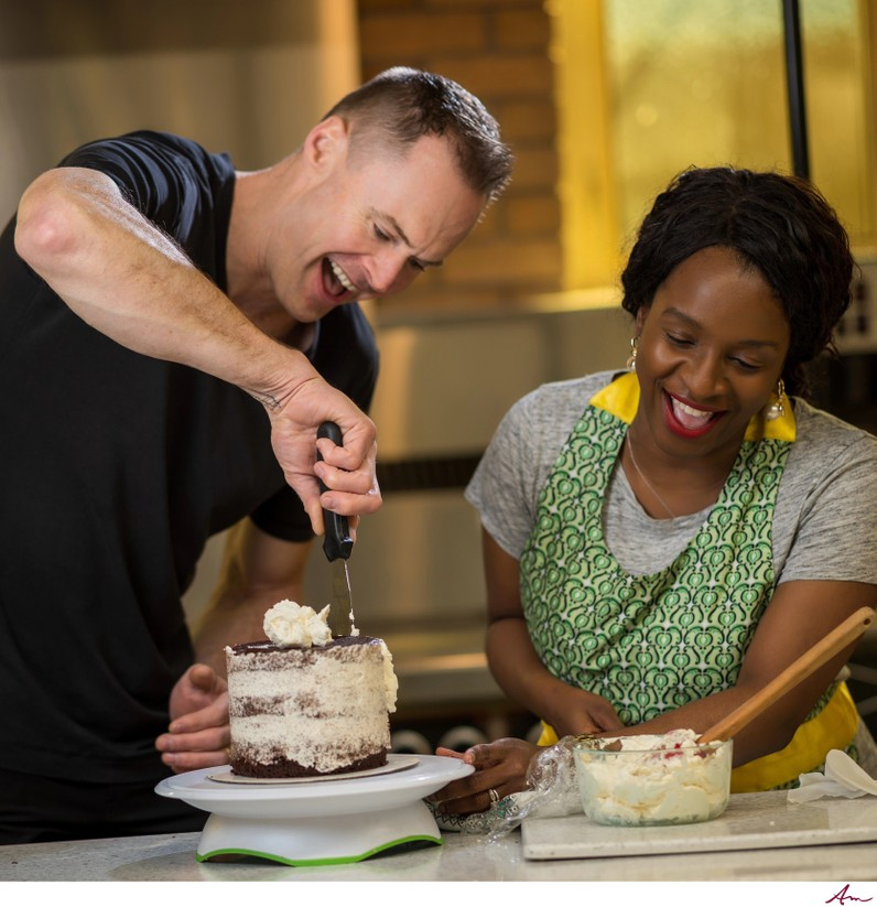 Temi showing Alex the ropes on the art of wedding cakes