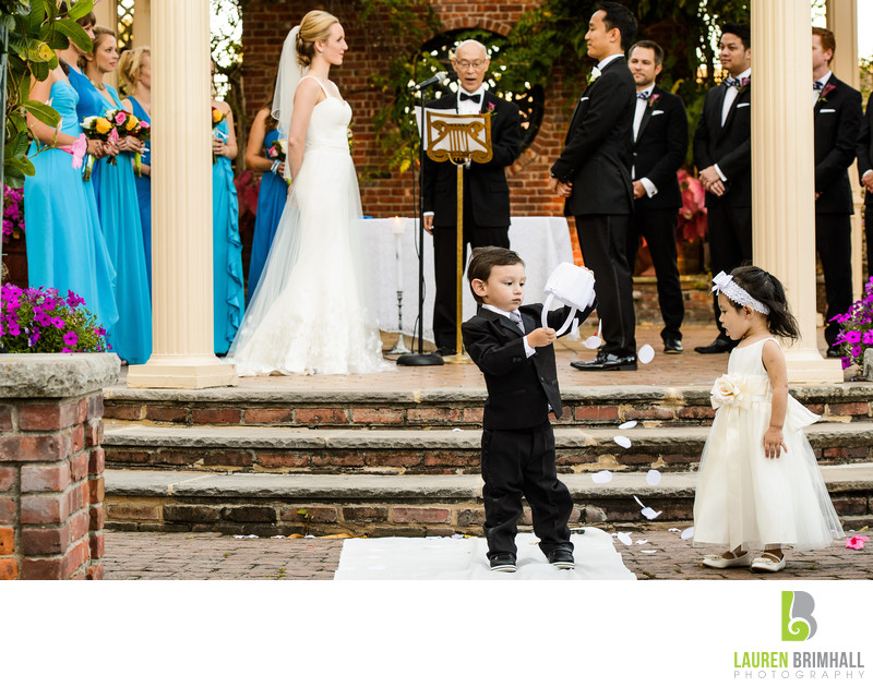 Ring Bearer dumps flower girl petals