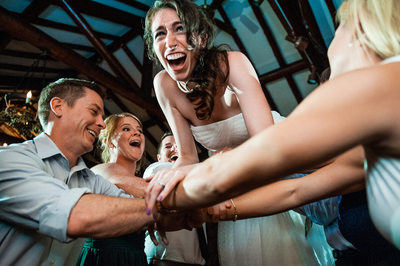 Bride Crowd Surfing at Reception