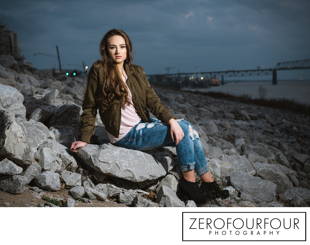 Edgy senior shoot on the rocks at night in the city