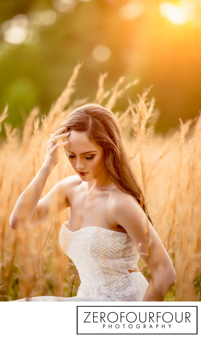 Natural light Senior photo in long grass at Rosedown