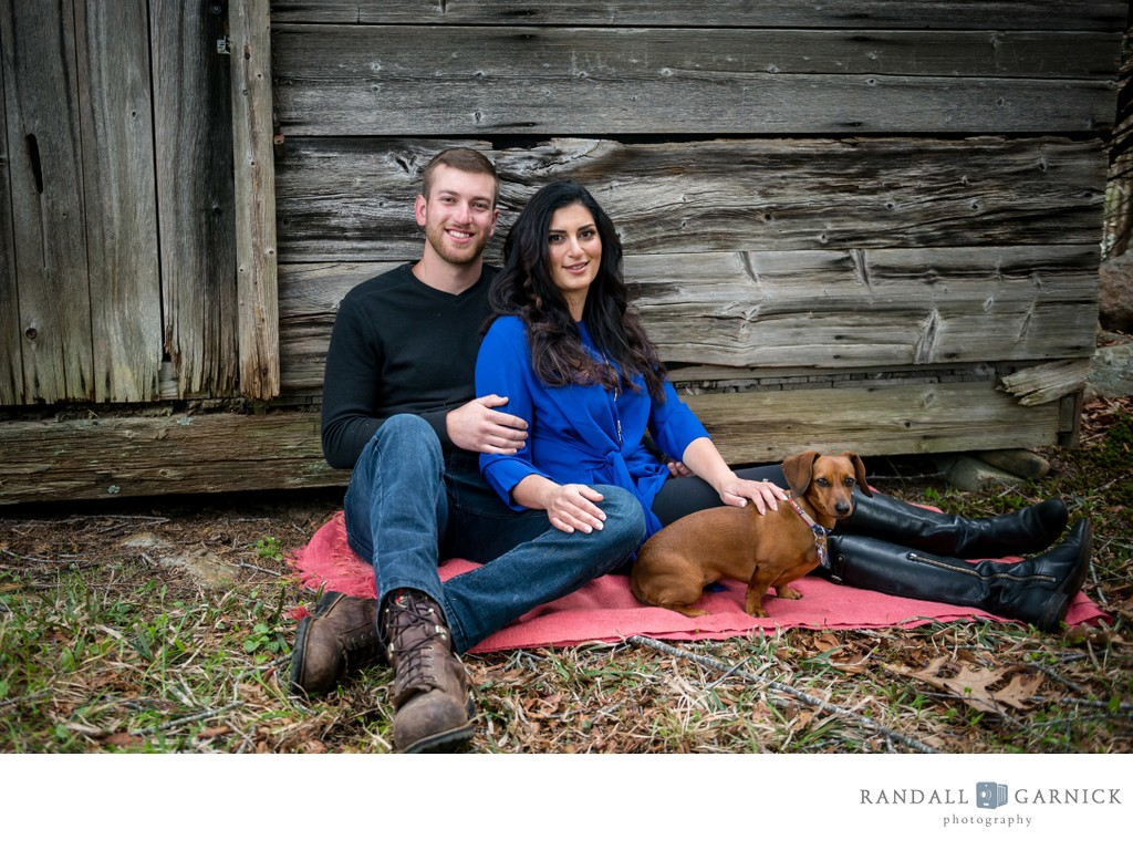 Rustic farm engagement session with cute dog