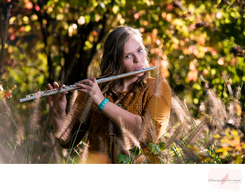 Senior Girl Portrait At Wildwood Park Playing Flute