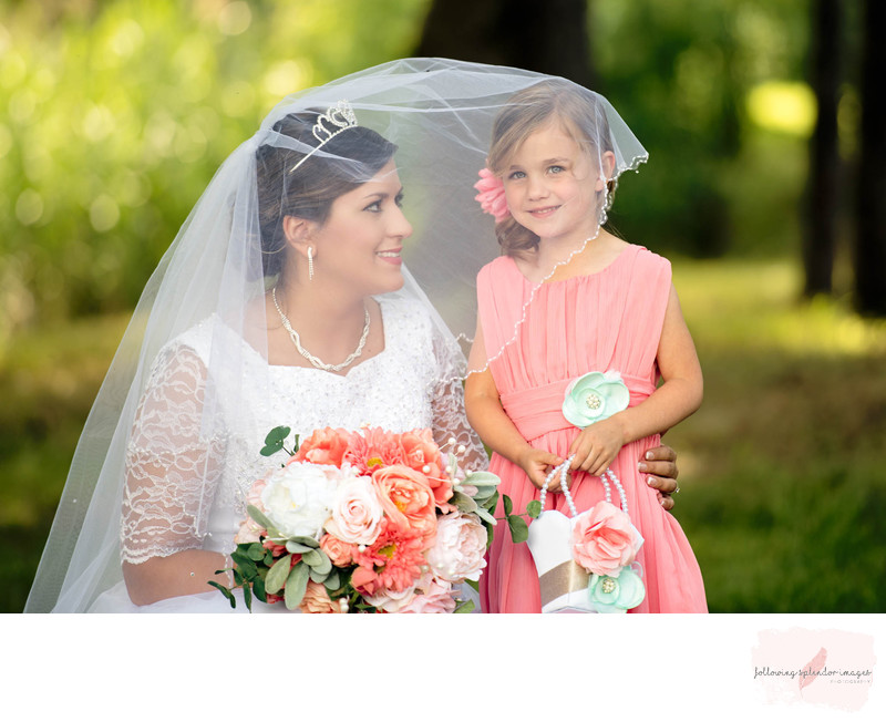 Bride and Flower Girl Under Veil