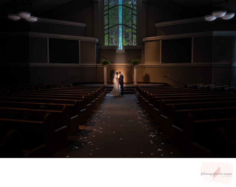 Wedding portrait in a beautiful church in front of windows