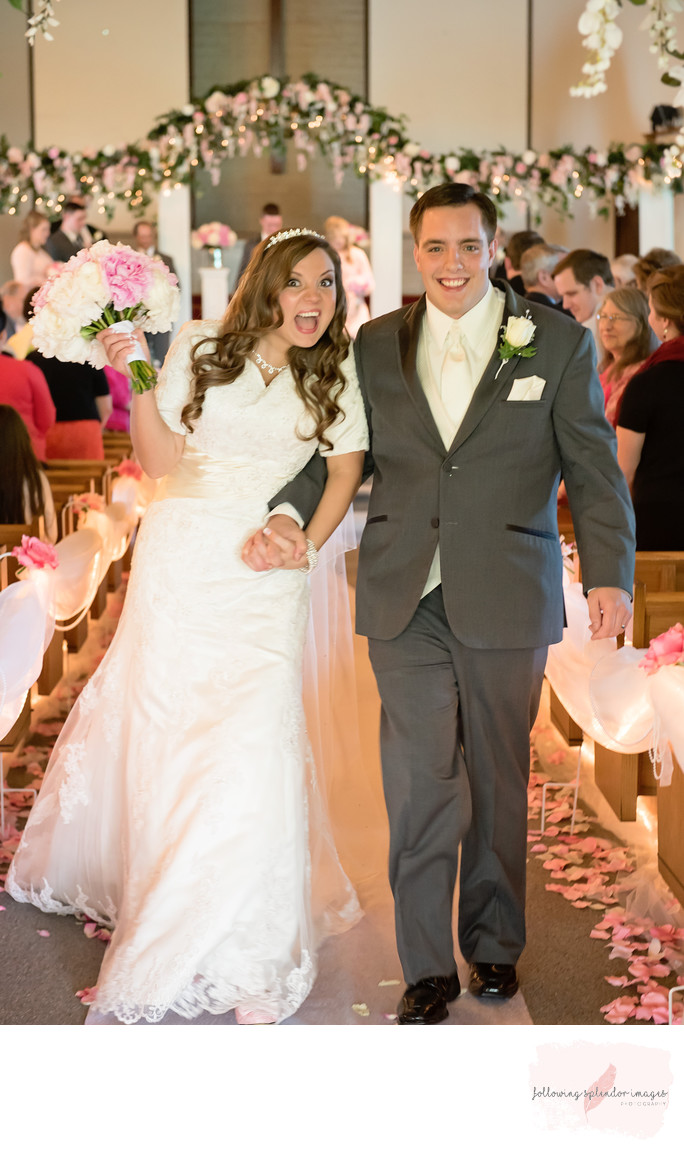 Smiling Bride and Groom after a Pink Wedding
