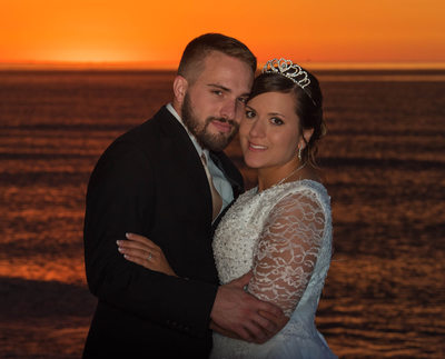 Bride and Groom Beach Sunset Cheek to Cheek Portrait