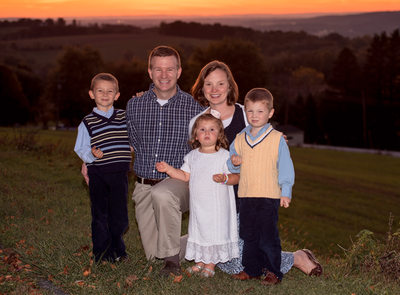 Fall sunset family photo with 3 small children