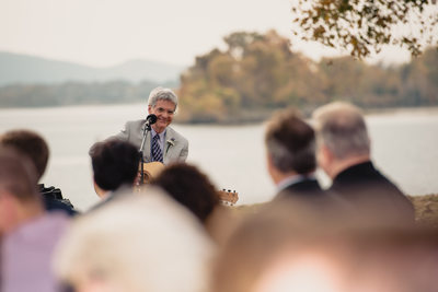 Groom's Father Playing Guitar for Wedding Ceremony