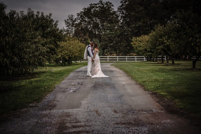 Bride and Groom walking down lane