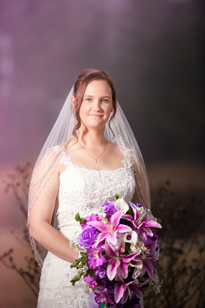 Bride with a beautiful bouquet of various purple flowers