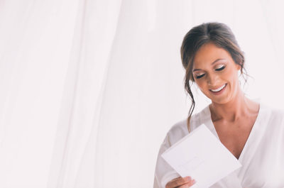Bride reads a letter from her future husband on her wedding