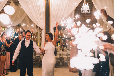 Bride and Groom Running through their Sparkler Exit