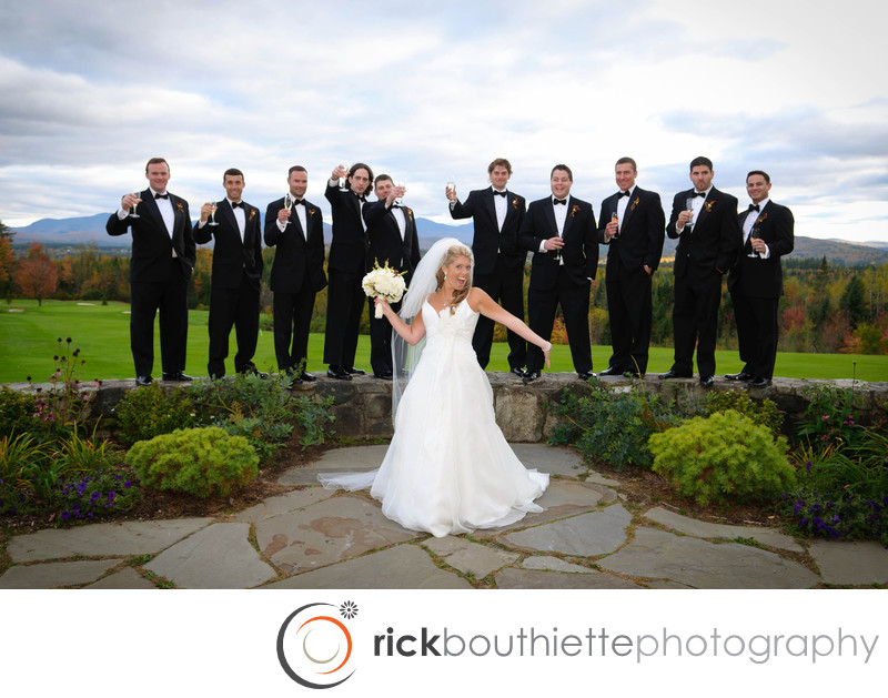 bride with groomsmen at great north woods wedding
