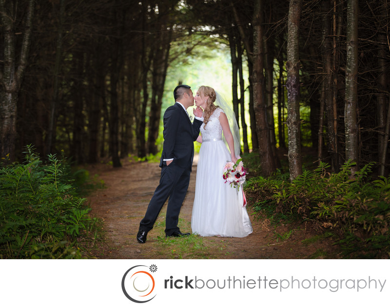 BRIDE AND GROOM IN THE FOREST AT BISHOP FARM WEDDING