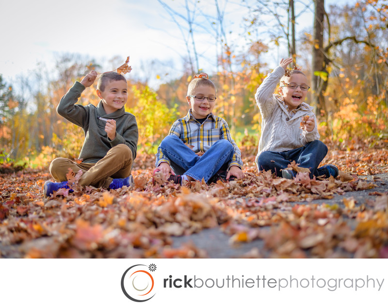 Modern Family Portraits - Kids Playing In The Leaves