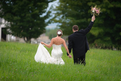 HAPPY COUPLE WALKING IN HAY FIELD - FRATELLO'S WEDDING