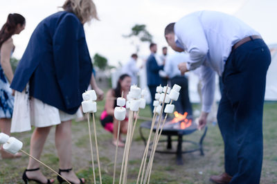 Toasting Marshmallows At Seacoast Science Center Wedding