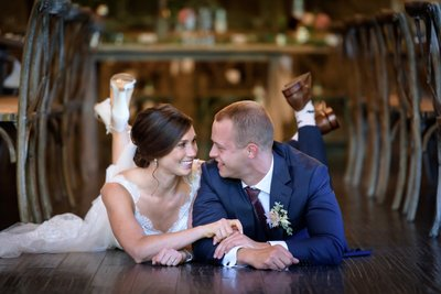 Bride & Groom Laying On Venue Floor At The Thompson Inn